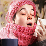 sneezing ill young woman