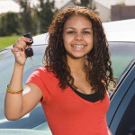 girl smiling with car keys