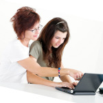 mom and teen on computer