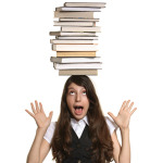 girl balancing books on head
