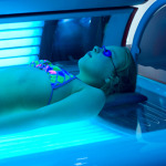 girl in tanning booth