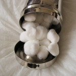 canister-with-cotton-balls
