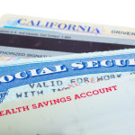 Social security and driver license cards isolated on white.